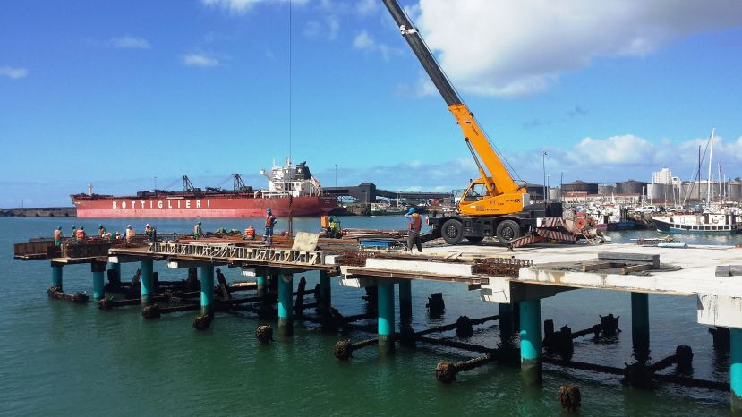 A crane in action during the construction of the lead-in jetties