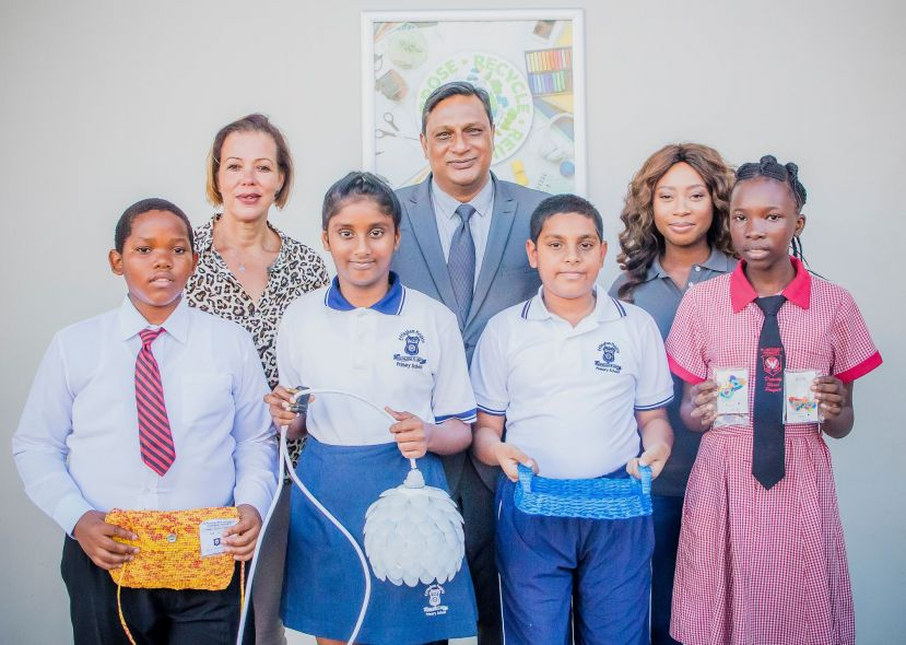 RECYCLING WINNERS – in front are: Kethu Makhathini (3rd); Gabriella Achary (1st); Mohammed Aqueel Khan (3rd); Esperance Mishehe (2nd) with Bernice Clarisse (Park Boulevard – Broll Property Manager), Loganathan Pillay (Principal of Effingham Heights Primary); Ruth Mthembu (Wildtrust).
